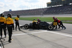 A Luczo Dragon Racing crew member goes upside Marty Roth's head after being ran into and then ran over. -Photo by Shawn Payne, IndyCar.com