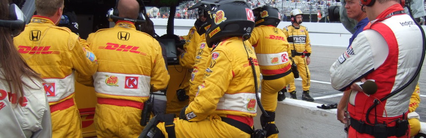 "Ryan Hunter-Reay's team watches the radar during the ""last"" caution for rain."